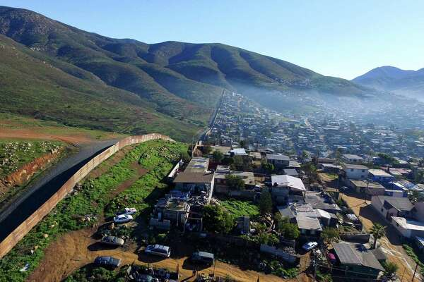 Aerial picture taken with a drone of the urban fencing on the border between the U.S. and Mexico at El Nido del Aguila, at the outskirts of Tijuana, Mexico on Thursday. President Donald Trump's border wall proposal and another to impose a tax on Mexican imports threatens an all-out trade war.