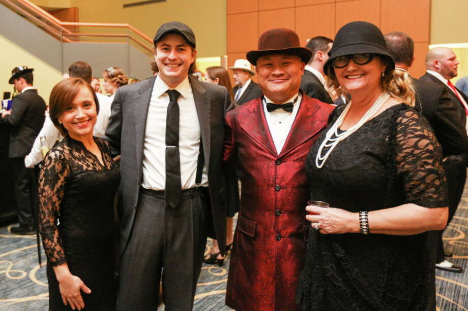 From the left: Holly Mitchell, Dick Schissler, Jason and Leo Ohn pose for a photo during the Chairman's Ball on Saturday, Jan. 21, 2017, at La Torretta Lake Resort & Spa. Photo: Michael Minasi, Staff Photographer / © 2017 Houston Chronicle
