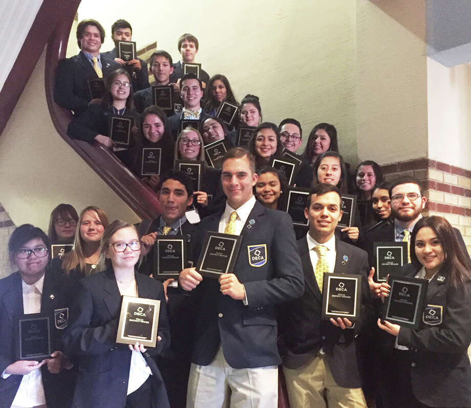 Plainview High School DECA members display the awards they received at the District 8 Career Development Conference.