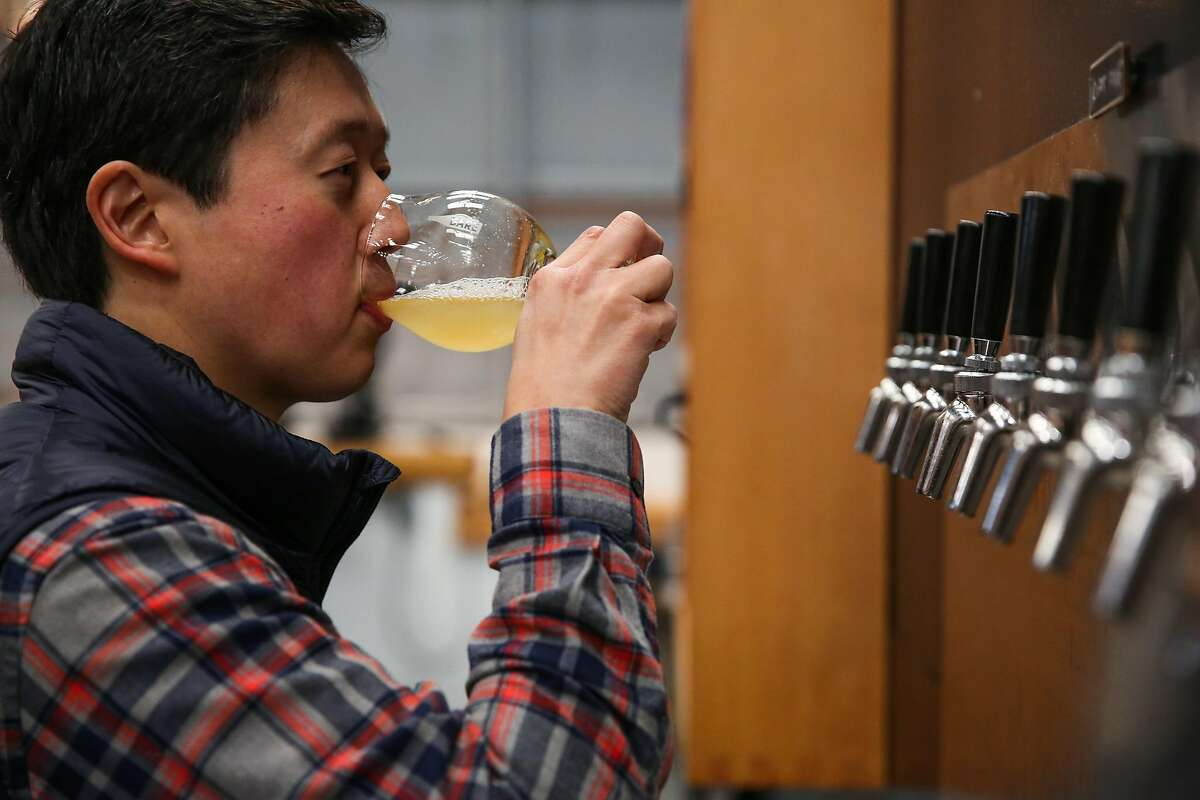 Founder Lester Koga drinks a glass of beer at Barebottle Brewery in San Francisco, California, on Wednesday, Jan. 25, 2017.