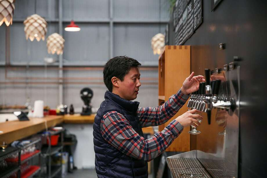 Founder Lester Koga fills up a glass of beer at Barebottle Brewery. Photo: Gabrielle Lurie, The Chronicle