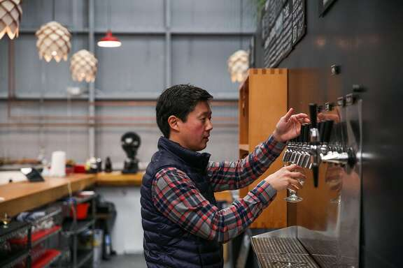 Founder Lester Koga fills up a glass of beer at Barebottle Brewery in San Francisco, California, on Wednesday, Jan. 25, 2017.