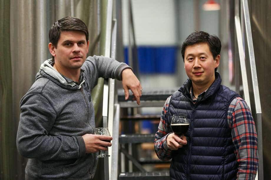 Barebottle co-founders Mike Seitz (left) and Lester Koga at their Bernal Heights brewery. In response to customers' requests for wine at the taproom, Barebottle has begun making some of its own wine. Photo: Gabrielle Lurie / The Chronicle 2017