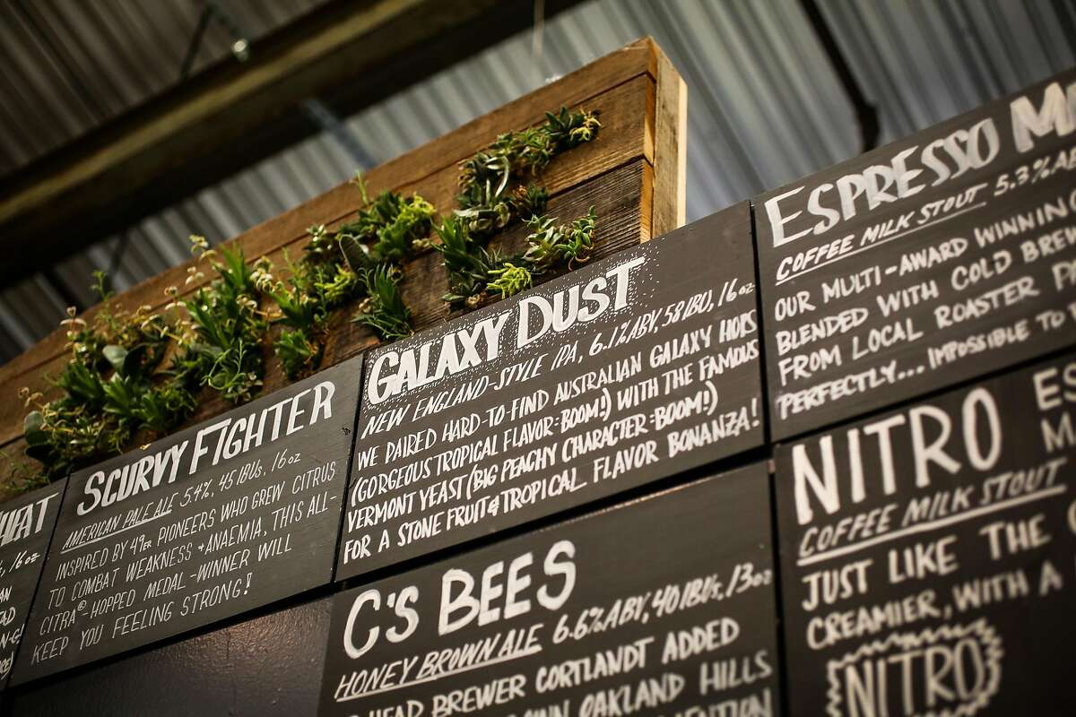 The menu of various beers is seen above the bar at Barebottle Brewery in San Francisco, California, on Wednesday, Jan. 25, 2017.