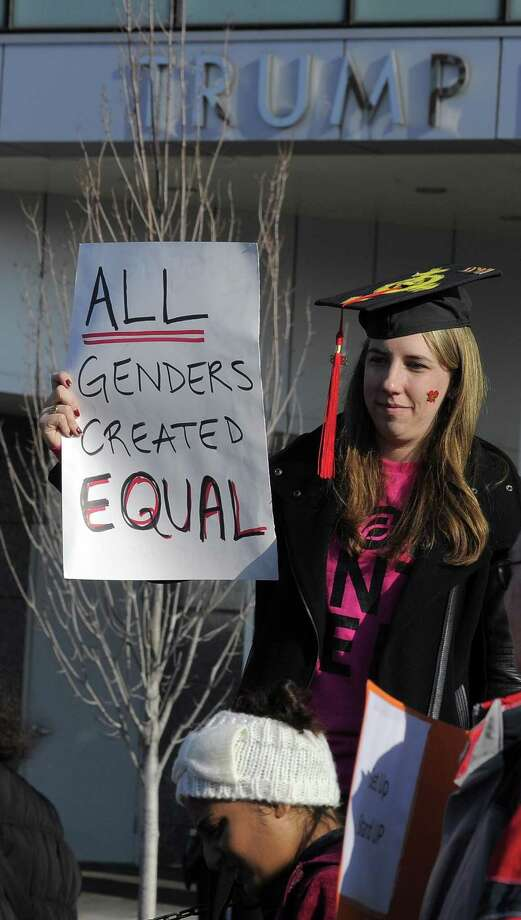 Taylor Bolton of New Canaan protests outside of Stamford's Trump Parc during the Women's March on Stamford on Jan. 21. Photo: Matthew Brown / Hearst Connecticut Media / Stamford Advocate