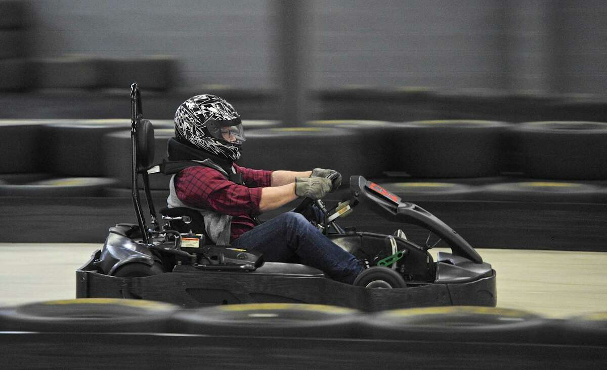 The track is a blur as Dave Tetley, of Fairfield, heads down a straightaway during open drive time at On Track Karting in Brookfield on Jan. 14. The indoor karting track was offering open track time midday after holding a one hour one hundred lap race in the morning.
