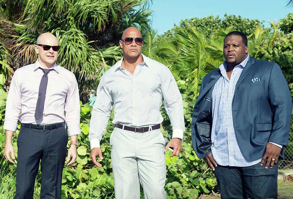 Dwayne Johnson (center) with the cast of