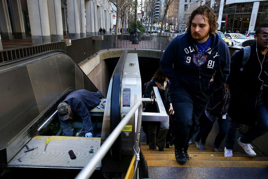 Workers maintain the Embarcadero BART Station escalator on Friday, Jan. 27, 2017, in San Francisco, Calif. Photo: Santiago Mejia, The Chronicle
