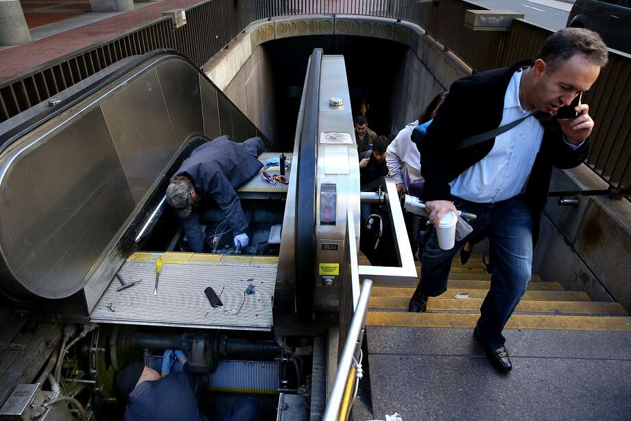 BART workers maintain the escalator at the Embarcadero Station. Photo: Santiago Mejia, The Chronicle