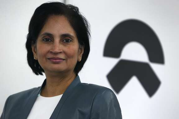 Padmasree Warrior, the CEO of the U.S. operations of NIO, is seen with the company's new corporate logo in San Jose, Calif. on Wednesday, Jan. 25, 2017. China-based NIO, which until recently was known as NextEV, is developing autonomous electric vehicles.
