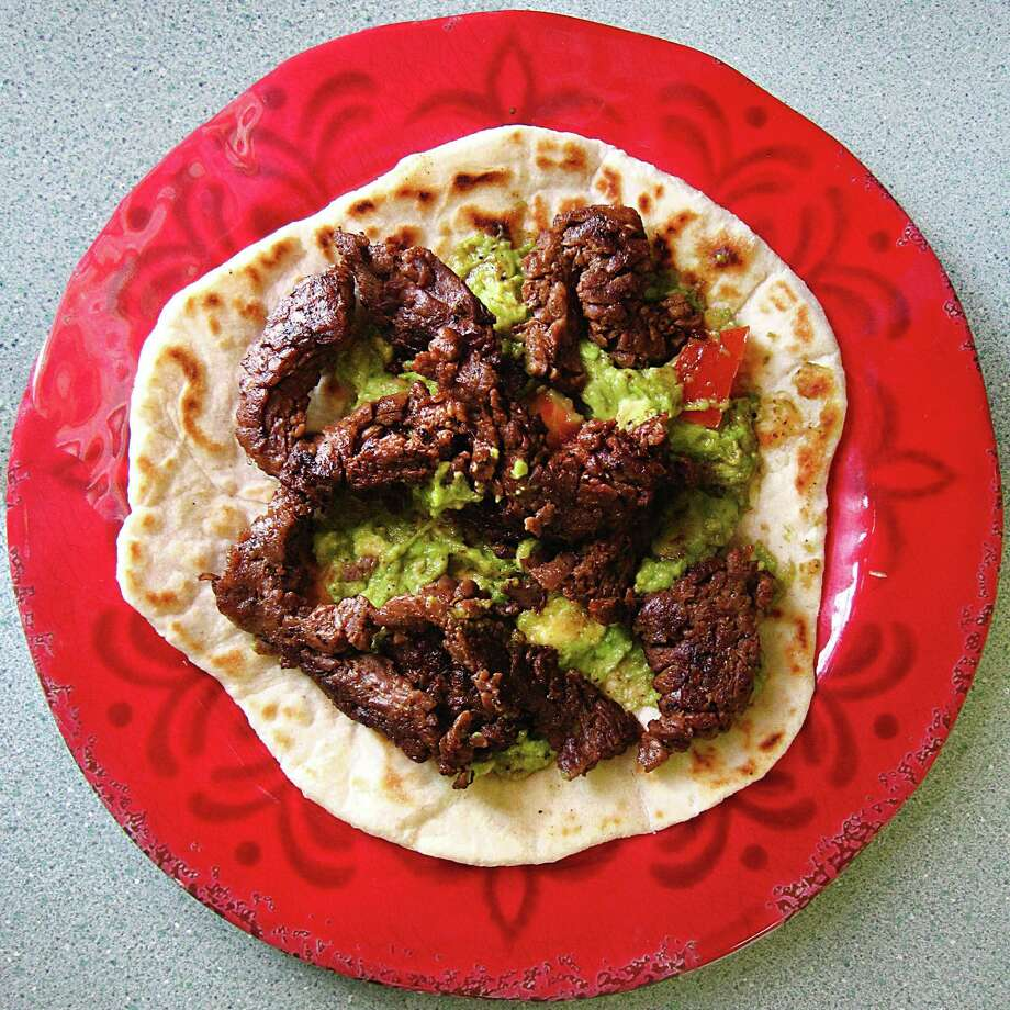 Beef fajita taco with guacamole on a handmade flour tortilla from Mendez Cafe. Photo: Mike Sutter /San Antonio Express-News