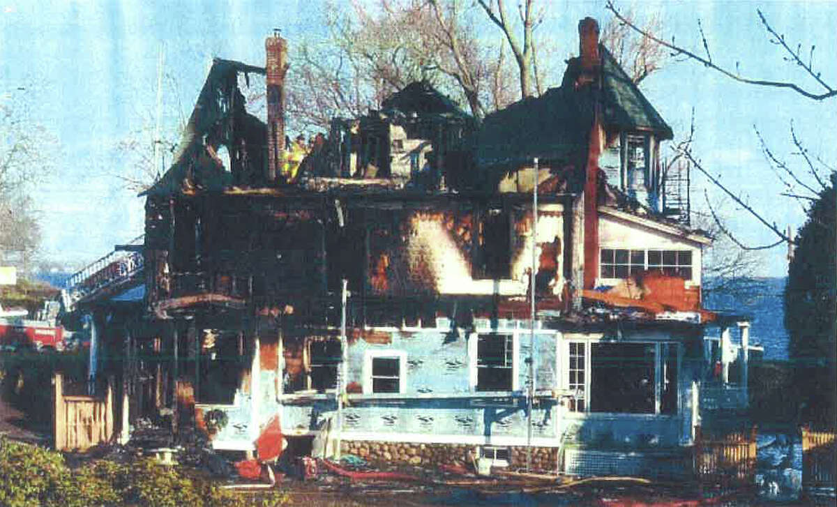 Five people, including three children, were killed in a Dec. 25, 2011 fire in the Shippan section of Stamford. New photos of the scene were included in depositions in Matthew Badger's lawsuit against the city of Stamford. Badger's three daughters were killed in the fire.