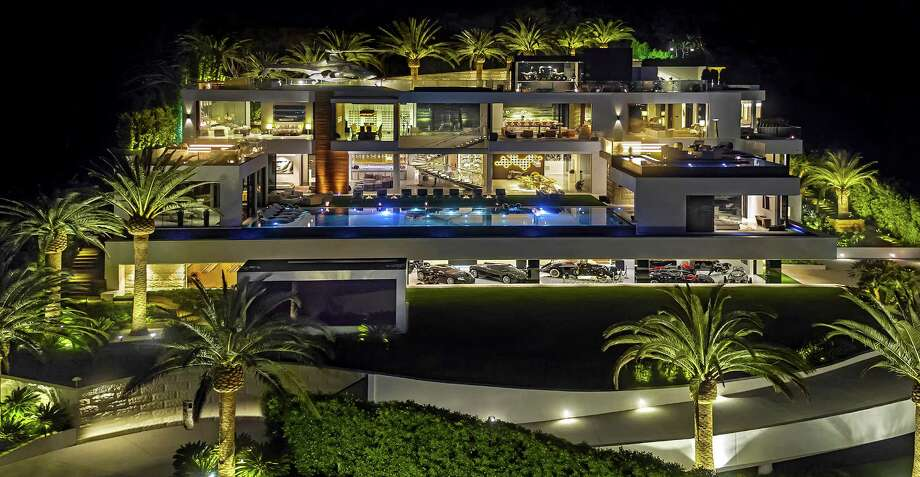 The 38,000-square-foot spec house in Bel-Air took four years and 250 workers to build. A $30-million car collection, custom furnishings and a range of amenities are included in the $250-million price tag. (Bruce Makowsky/BAM Luxury Development) Photo: Bruce Makowsky / Los Angeles Times