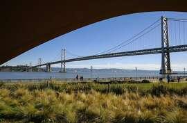 Along the Embarcadero at the San Francisco waterfront against the Bay Bridge in San Francisco, Ca., on Friday Jan. 27, 2017.