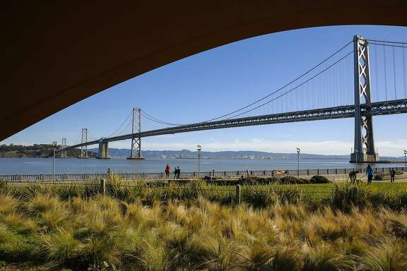 Along the Embarcadero at the San Francisco waterfront against the Bay Bridge in San Francisco, Ca., on Friday Jan. 27, 2017.