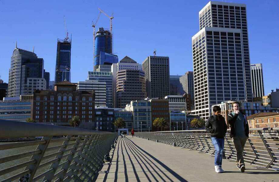 A walk along Pier 14 under sunny skies provides a reminder of San Francisco's charm. Photo: Michael Macor, The Chronicle