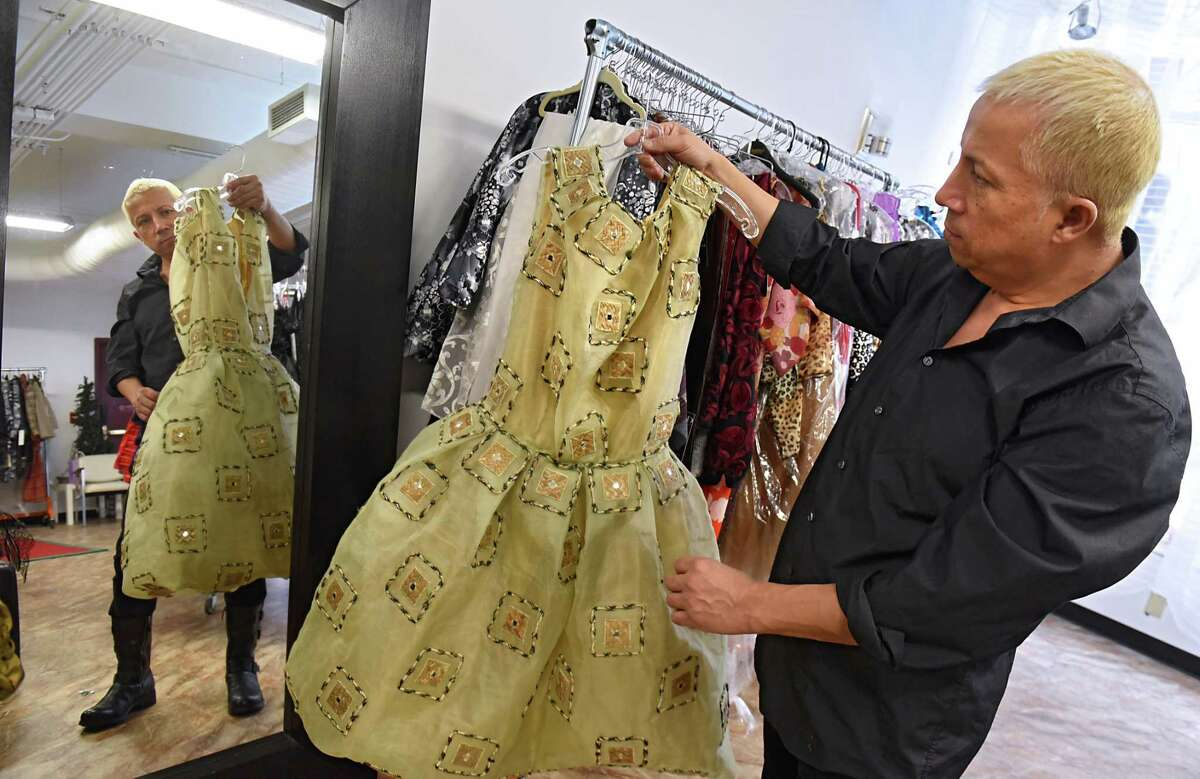 Daniel Mozzes holds one of his designs, in his studio, he will be showing at Harlem Fashion Week, a division of New York Fashion Week in New York City on Tuesday, Jan. 24, 2017 in Albany, N.Y. (Lori Van Buren / Times Union)