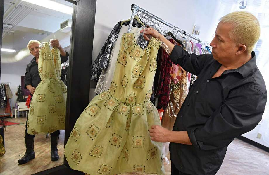 Daniel Mozzes holds one of his designs, in his studio, he will be showing at Harlem Fashion Week, a division of New York Fashion Week in New York City on Tuesday, Jan. 24, 2017 in Albany, N.Y. (Lori Van Buren / Times Union) Photo: Lori Van Buren / 20039516A
