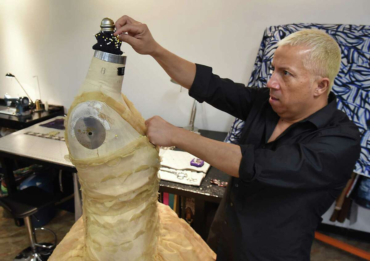 Daniel Mozzes works on one of his designs, in his studio, he will be showing at Harlem Fashion Week, a division of New York Fashion Week in New York City on Tuesday, Jan. 24, 2017 in Albany, N.Y. (Lori Van Buren / Times Union)