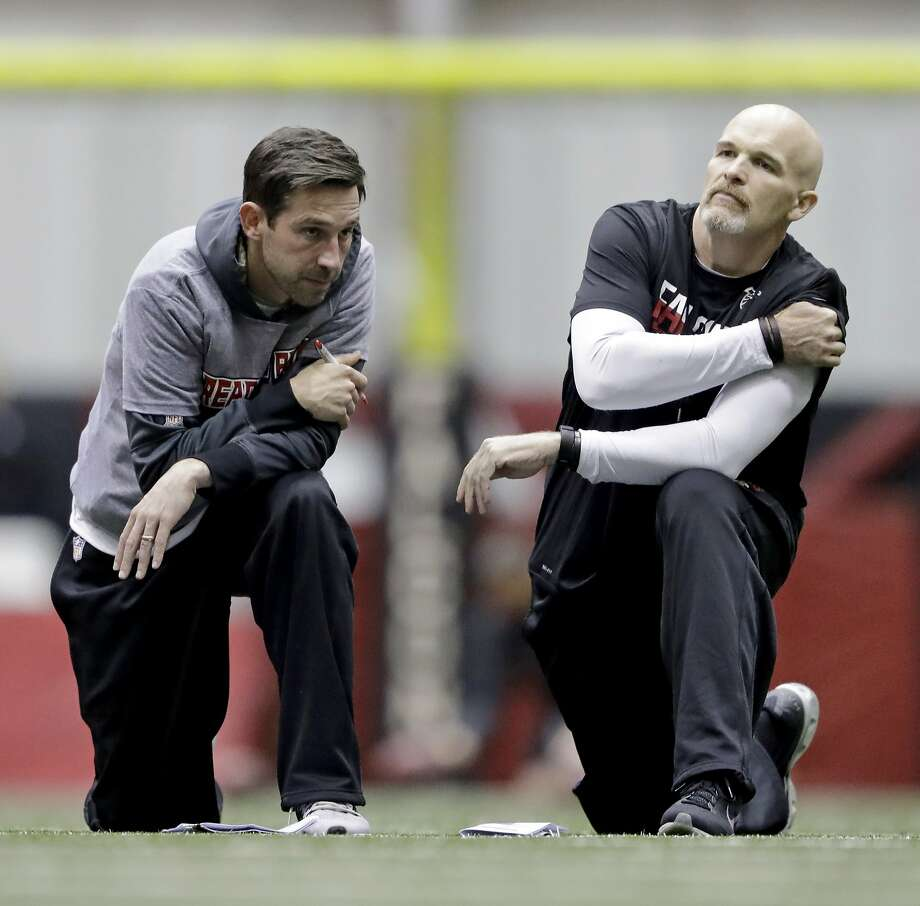 Kyle Shanahan (left) is taking his lumps for his play-calling in the Falcons' Super Bowl loss, but head coach Dan Quinn (right) should also have to answer. Photo: David Goldman, Associated Press