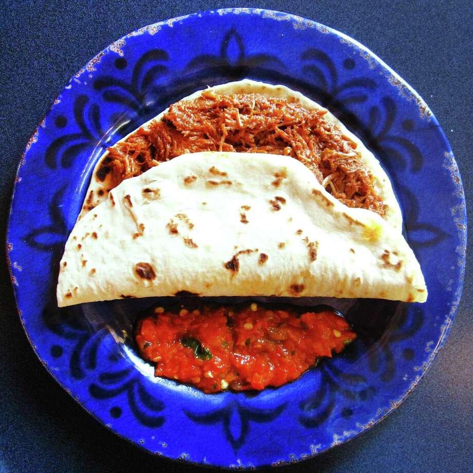 Carne deshebrada taco on a handmade flour tortilla from Taquería Anahuac. Photo: Mike Sutter /San Antonio Express-News