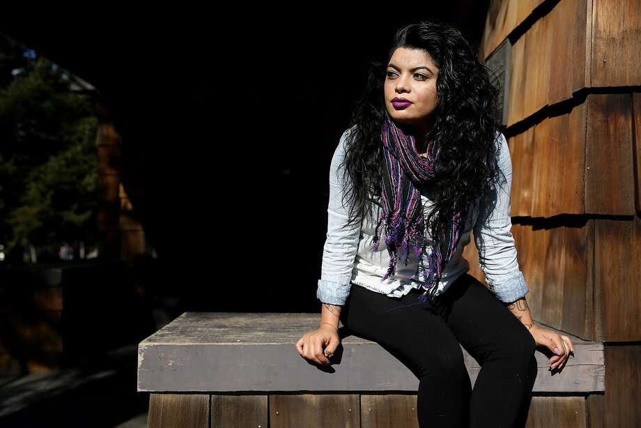 Valeska Casta–eda-Puerto, 29, sits for a portrait at UC Berkeley on Friday, Jan. 27, 2017 in Berkeley, Calif. Casta–eda-Puerto is the coordinator of student support for the Cal Alumni association. She graduated from UC Berkeley in American Studies with a concentration in race, class and gender within immigration policies. She is a permanent resident through her mother, who also is a permanent resident through political asylum from Nicaragua. She said she condemns President Donald Trump's actions because it dehumanizes people and creates racism and divide. Photo: Santiago Mejia, The Chronicle