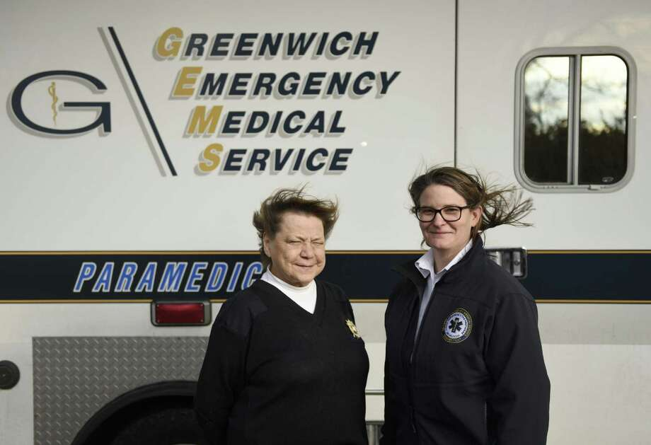 Outgoing Greenwich Emergency Medical Service (GEMS) Executive Director Charlee Tufts, left, poses beside new Executive Director Tracy Schietinger at the GEMS headquarters in the Riverside section of Greenwich, Conn. Thursday, Jan. 26, 2017. Tufts, the only Executive Director in GEMS history, is retiring and passing the torch to Schietinger. Photo: Tyler Sizemore / Hearst Connecticut Media / Greenwich Time