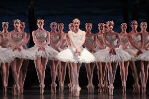 Sara Webb, center, performs with other artists of Houston Ballet in a scene from Swan Lake, choreographed by Stanton Welch. The Tchaikovsky favorite will be a highlight of the company's 2017-18 season.