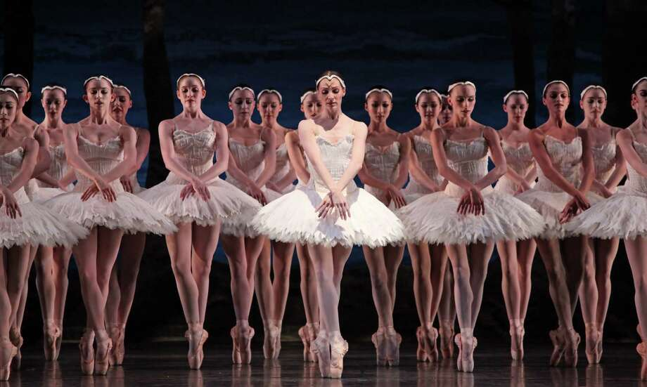 Sara Webb, center, performs with other artists of Houston Ballet in a scene from Swan Lake, choreographed by Stanton Welch. The company will perform the Tchaikovsky favorite at Jones Hall June 23-July 1. Photo: Amitava Sarkar / handout