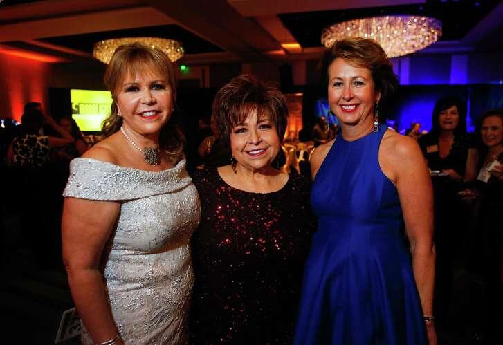 Chairs Cyndy Garza Roberts, from left, Trini Mendenhall and Ileana Trevino