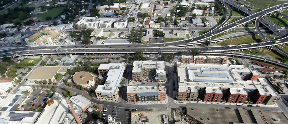 Upgrades on the Broadway corridor, seen in 2012, are attracting unprecedented private investment. Continuing such progress depends on voters approving a city bond measure in May. Photo: San Antonio Express-News / File Photo / © 2012 San Antonio Express-News