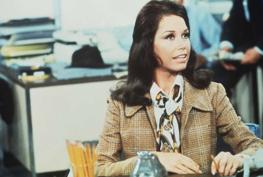 Since Mary Tyler Moore's passing in January, we've been thinking a lot about how her onscreen persona, Mary Richards, affected women in the workplace. Her wardrobe was a small-screen shift from full skirts and kitten heels to colorful pantsuits and separates that didn't restrict her as a single, professional woman making it in the big city. Photo: Getty Images, CBS Photo Archive