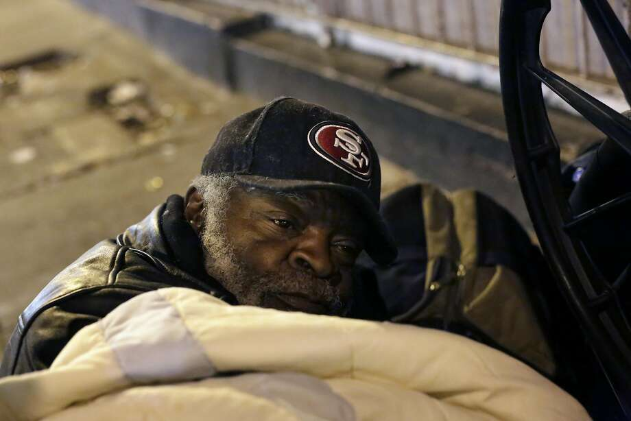 Jerome Applewhite lies under a blanket on Golden Gate Avenue during the biennial census Thursday. Photo: Lea Suzuki, The Chronicle