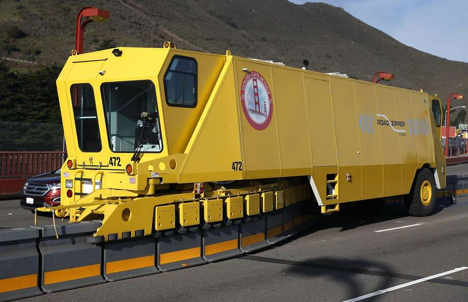 A barrier mover similar to this one on the Golden Gate Bridge will be used to periodi cally shift a bike-lane barrier  on the Richmond- San Rafael Bridge. Photo: Paul Chinn, The Chronicle