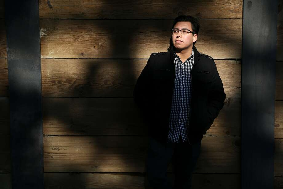 Luis Avalos, 23, stands for a portrait at the City College of San Francisco on Thursday, Jan. 26, 2017 in San Francisco, Calif. Avalos and his family immigrated to the United States from Michoacan, Mexico, when he was three years old. At six, Avalos was diagnosed with Optic Nerve Atrophy, a condition which limits his eye sight. He tries to grab a seat in the front of class early. He was granted Deferred Action for Childhood Arrivals (DACA) in 2012. Because of DACA, he was able to work for the S.F. Youth Commission. President Donald Trump said he's going to make changes to DACA in the next few weeks. Avalos, who is studying to be an immigration attorney, is worried about his future under President Trump. Photo: Santiago Mejia, The Chronicle