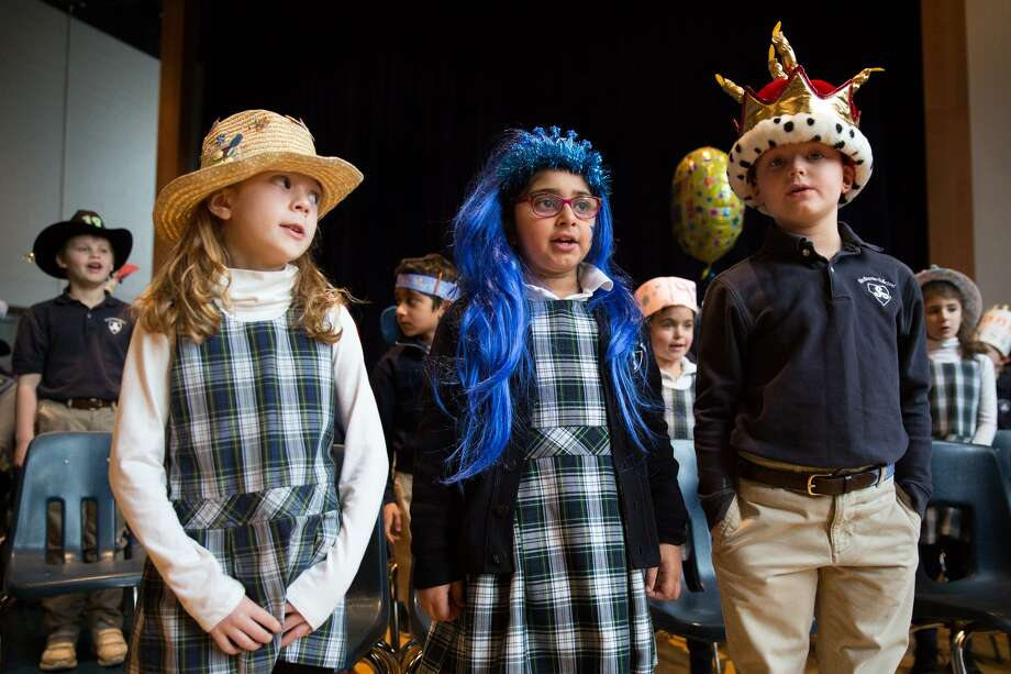 """Eva Hart, Riya Sharma and Connor Yantz sing """"The Heart of Stanwich"""" during the 19th birthday celebration of the the Stanwich School on Friday morning in Greenwich, Conn. Photo: Chris Palermo / For Hearst Connecticut Media / Greenwich Time Freelance"""