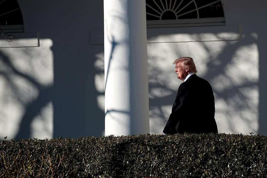 President Trump walks along the West Wing Colonnade on his way to the Oval Office at the White House. Photo: Drew Angerer, Getty Images
