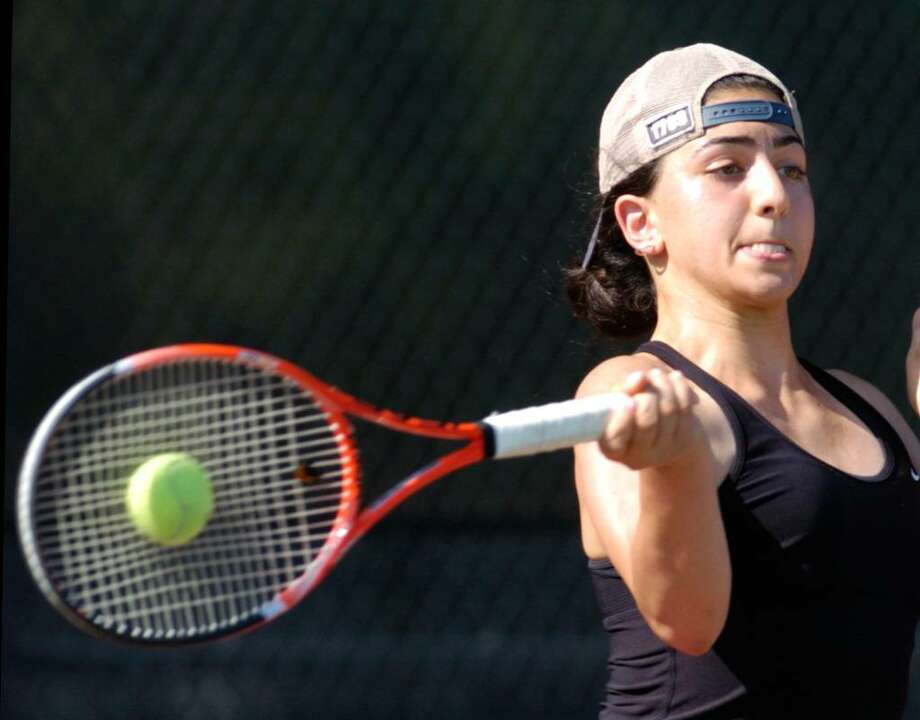 Tina Tehrani of the New Canaan High School girls tennis team during her FCIAC Championship match against Jen DeLuca of Greenwich High School, at Wilton High School, Tuesday, May 26, 2010.  Tehrani defeated Deluca 6-0, 6-0, and New Canaan defeated GHS, 5-2 to take the championship. Photo: Bob Luckey, ST / Stamford Advocate