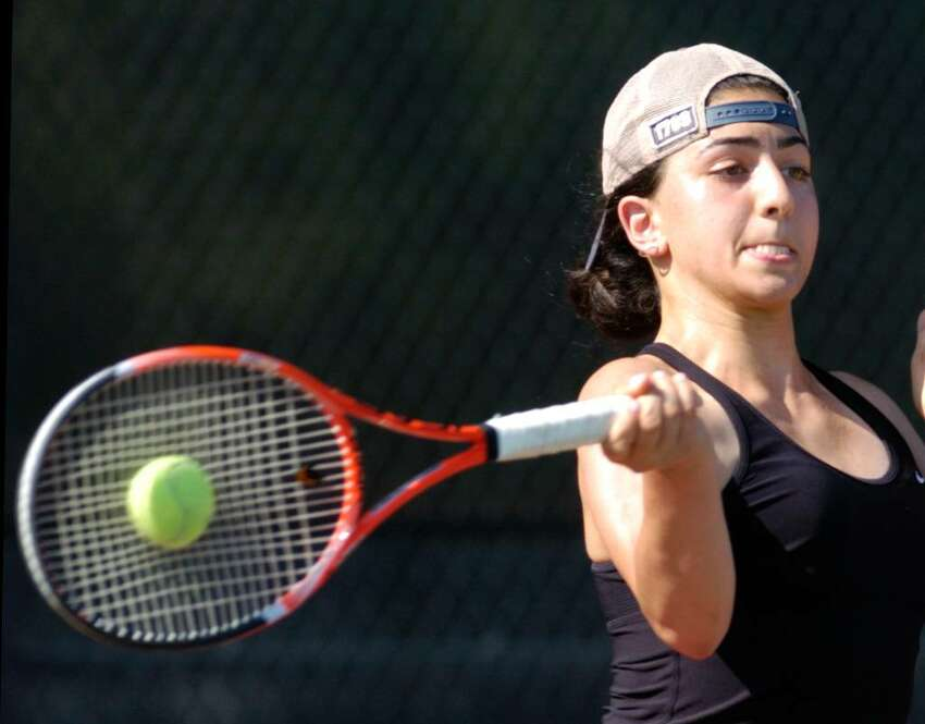 Tina Tehrani of the New Canaan High School girls tennis team during her FCIAC Championship match against Jen DeLuca of Greenwich High School, at Wilton High School, Tuesday, May 26, 2010. Tehrani defeated Deluca 6-0, 6-0, and New Canaan defeated GHS, 5-2 to take the championship.