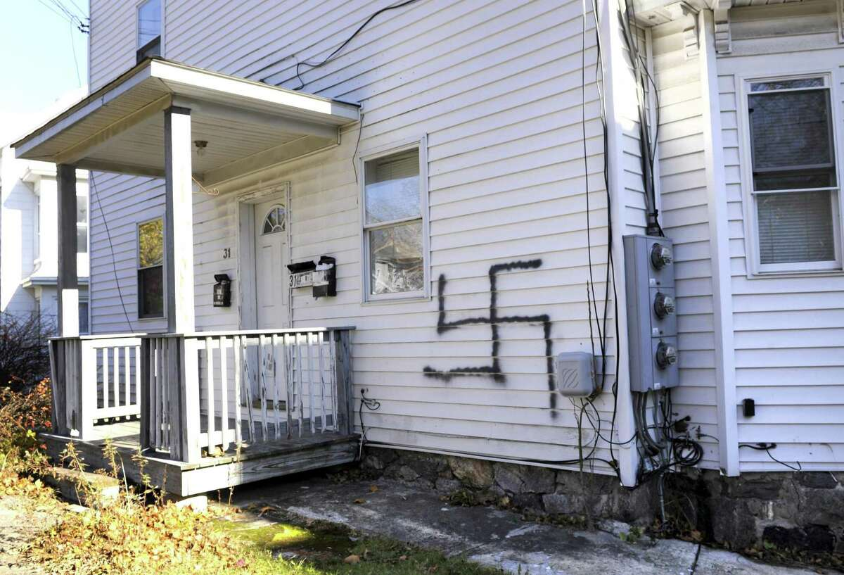A swastika symbol was painted on a home and on a car on Division Street in Danbury sometime over the weekend. Photo Monday, Nov. 14, 2016.
