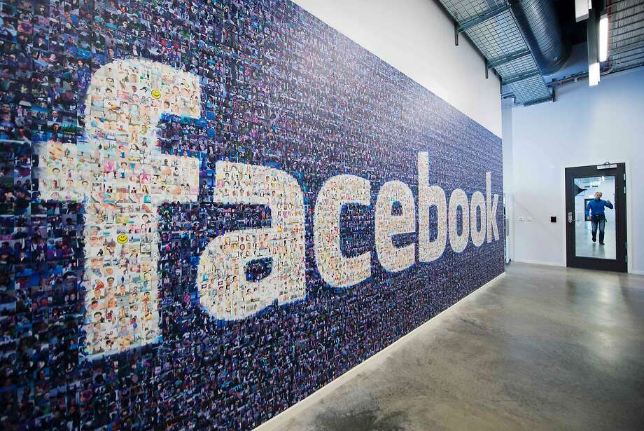 (FILES) This file photo taken on November 07, 2013 shows a giant logo created with pictures of Facebook worldwide users is pictured in the company's Data Center, its first outside the US on November 7, 2013 in Lulea, in Swedish Lapland.  Facebook could be using its dominant market position to violate data protection rules, Germany's competition watchdog, the Federal Cartel Office, said on March 2, 2016, announcing it had opened a corresponding probe against the  social network. / AFP / JONATHAN NACKSTRANDJONATHAN NACKSTRAND/AFP/Getty Images Photo: JONATHAN NACKSTRAND, AFP/Getty Images