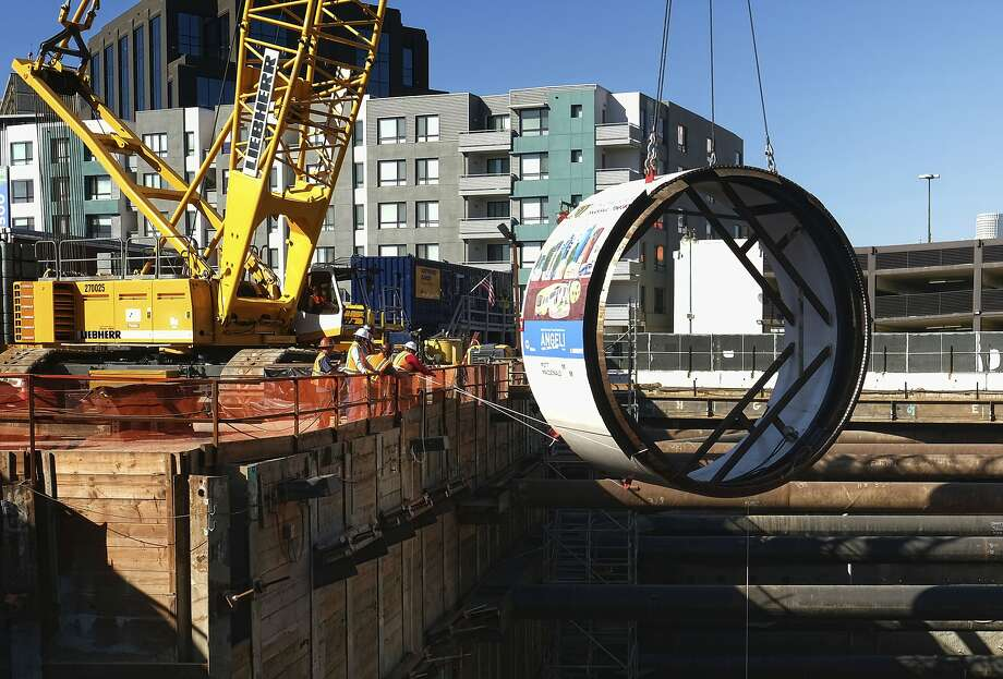 """Workers lower the tail shield section of a tunnel boring machine into a 45 foot deep pit, during a ceremonial naming and lowering for the Regional Connector Transit Project downtown Los Angeles. Just weeks after suddenly tweeting """"Traffic is driving me nuts"""" and """"am going to build a tunnel boring machine and just start digging,"""" Elon Musk, the SpaceX and Tesla founder says it's on the verge of happening. """"Exciting progress on the tunnel front,"""" he tweeted Wednesday, Jan. 25, 2017. """"Plan to start digging in a month or so."""" Photo: Richard Vogel, Associated Press"""