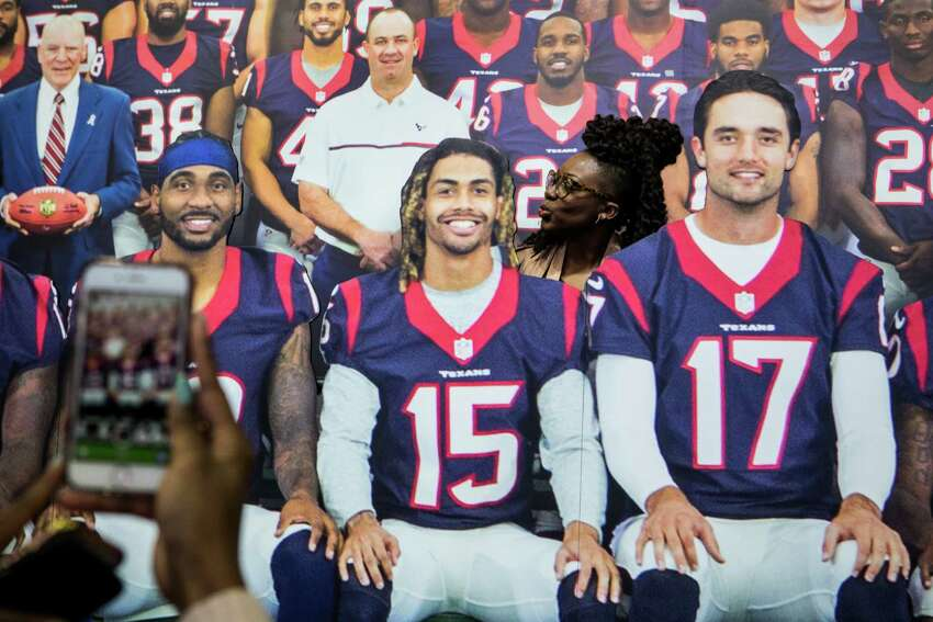 Charlette Washington poses for a photo in the Houston Texans team photo during a preview of NFL Experience driven by Genesis at the George R. Brown Convention Center on Friday, Jan. 27, 2017, in Houston. The interactive attraction opens to the public on Saturday.