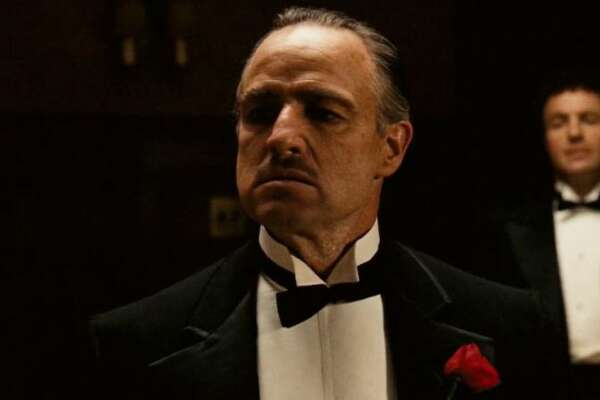 """#1. """"The Godfather""""   Smart Rating:  100.00  Run Time:  2 hours, 57 minutes  Starring:  Marlon Brando, Al Pacino, James Caan  Widely regarded as one of the greatest films of all time, this mob drama, based on Mario Puzo's novel of the same name, focuses on the powerful Italian-American crime family of Don Vito Corleone (Marlon Brando). When the don's youngest son, Michael (Al Pacino), reluctantly joins the Mafia, he becomes involved in the inevitable cycle of violence and betrayal. Although Michael tries to maintain a normal relationship with his wife, Kay (Diane Keaton), he is drawn deeper into the family business.    Learn More About Movies at PrettyFamous"""