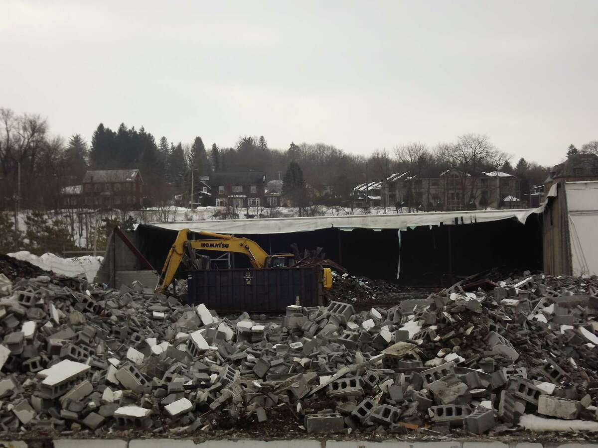 Demolition work continues this month at the former Beech-Nut plant in Canajoharie, where a hoped-for redevelopment of site is stymied by unpaid property taxes, problems with asbestos removal, and unpaid bills.