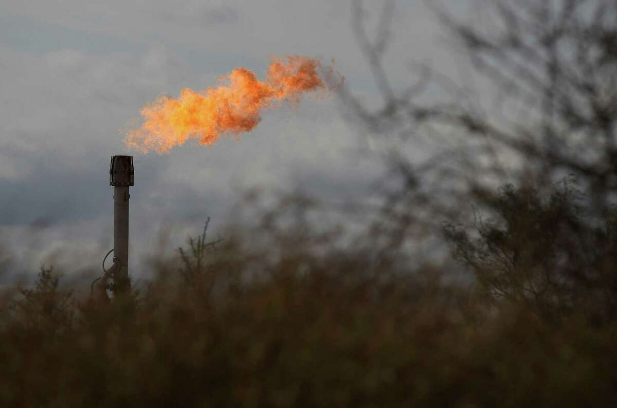 A gas flare burns on an oil lease in La Salle county. A report released July 7, 2017 by Texas environmental groups says the state imposes penalties on just 3 percent of maintenance and upset events at industrial sites, including oil and gas wells. (Kin Man Hui/San Antonio Express-News)