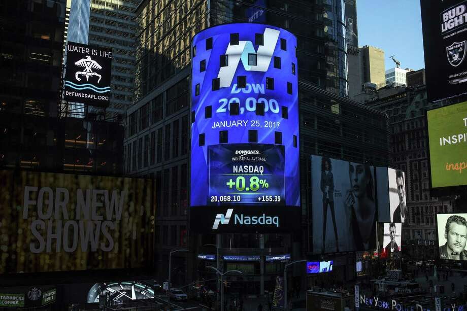 The display at Nasdaq Tower in New York's Times Square shows that the Dow Jones industrial average closed above the 20,000-point mark for the first time Wednesday. Photo: Rohini Shahriar /Associated Press / Copyright Nasdaq 2017