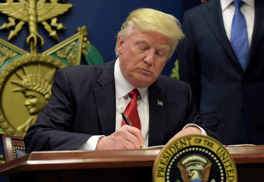President Donald Trump signs an executive order on extreme vetting during an event at the Pentagon in Washington, Friday, Jan. 27, 2017. (AP Photo/Susan Walsh) Photo: Susan Walsh, STF / Copyright 2017 The Associated Press. All rights reserved.