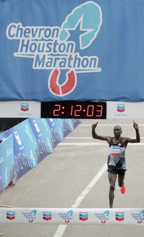 Dominic Ondoro crosses the finish line with a first place finish time of 2:12:05 during the Chevron Houston Marathon on Sunday, Jan. 15, 2017, in Houston. ( J. Patric Schneider / For the Chronicle ) Photo: J. Patric Schneider, Freelance / © 2017 Houston Chronicle