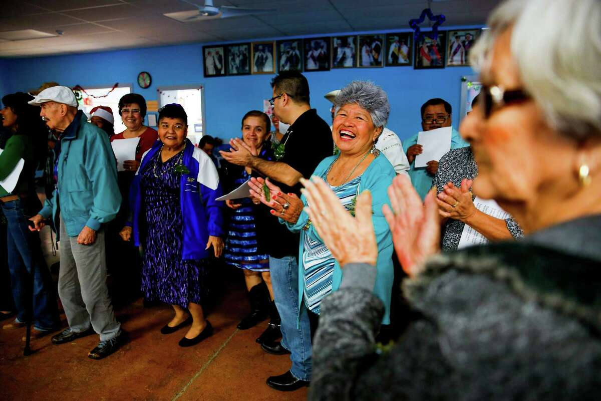 Seniors celebrate Las Posadas, a mainly Mexican Christmas tradition celebrating the journey Joseph and Mary made from Nazareth to Bethlehem, at La Plaza Adult Day Care Friday, Dec. 16, 2016 in Brownsville. ( Michael Ciaglo / Houston Chronicle )